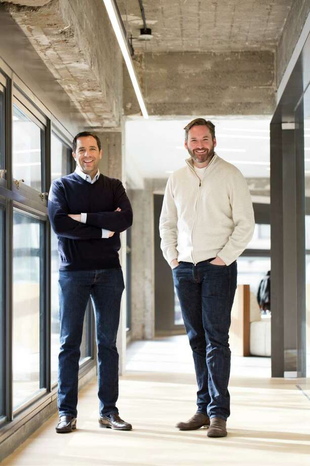 Stuart Peterson (left) and Mike Harden are co-founders of Artis Ventures in the Warfield bui. Photo: Tim Hussin / Special To The Chronicle / ONLINE_YES