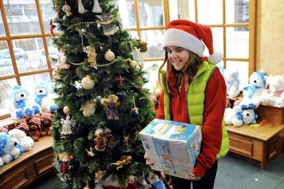 kylie mclaughlin 9 of colonie carries a gift as she participates in random acts - Mcdonalds Open Christmas Day 2014