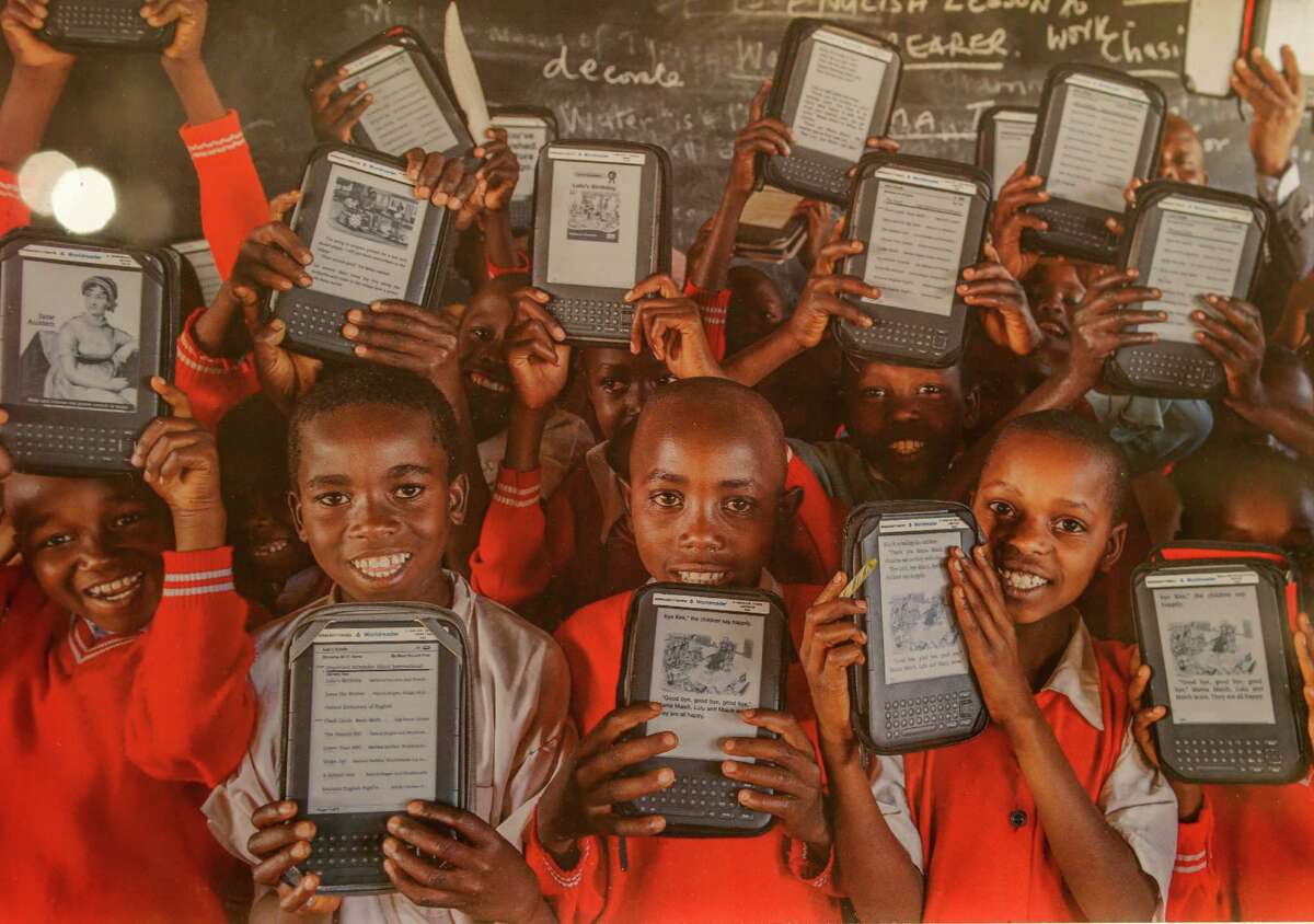 A photograph taken by Jon Mcormack recently shows some of the thankful students who have received books from Worldreader. Worldreader has put e-readers and phones loaded with book titles in the hands of 300,000 kids worldwide, mostly across sub-Saharan Africa.