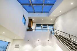 A skylight illuminates the spacious loft.