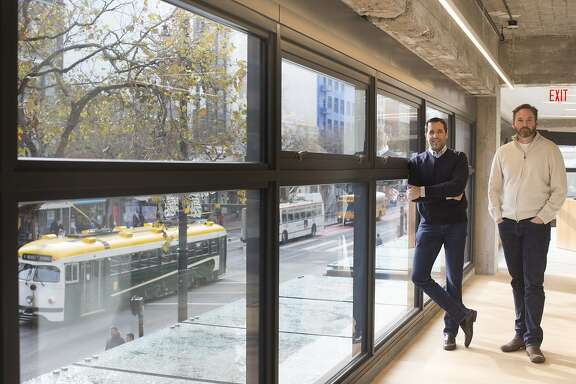 Stuart Peterson, left, and Mike Harden, right, co-founders of ARTIS Ventures, stand for a photo at the company's office in San Francisco, Calif. on Wednesday, December 17, 2014. The company recently moved to the Mid-Market neighborhood to the Warfield building, a historic office building that was vacant a few years ago but is now home to several companies, including Benchmark Capital, Spotify and Match.com.