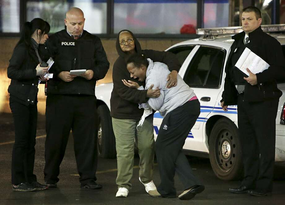 Toni Martin, front center, cries out on Wednesday, Dec. 24, 2014, as she talks to police at the scene where she says her son was fatally shot Tuesday at a gas station in Berkeley, Mo. Authorities did not immediately identify the man who was shot. But the St. Louis Post-Dispatch reported that Toni Martin, said he was her son, Antonio Martin. Photo: David Carson, Associated Press