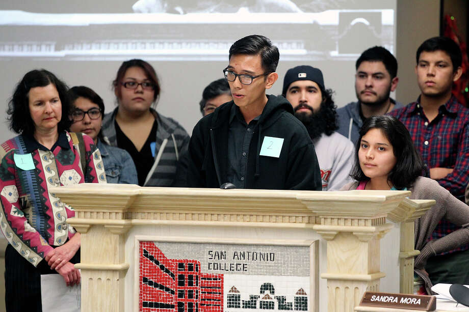 Simon Sanchez and Madelyn Martinez, speaking for the Student Leadership Coalition of Alamo Colleges, direct comments concerning the listing of majors on diplomas to the Alamo Community Colleges board of trustees during their meeting earlier this month. Photo: TOM REEL /