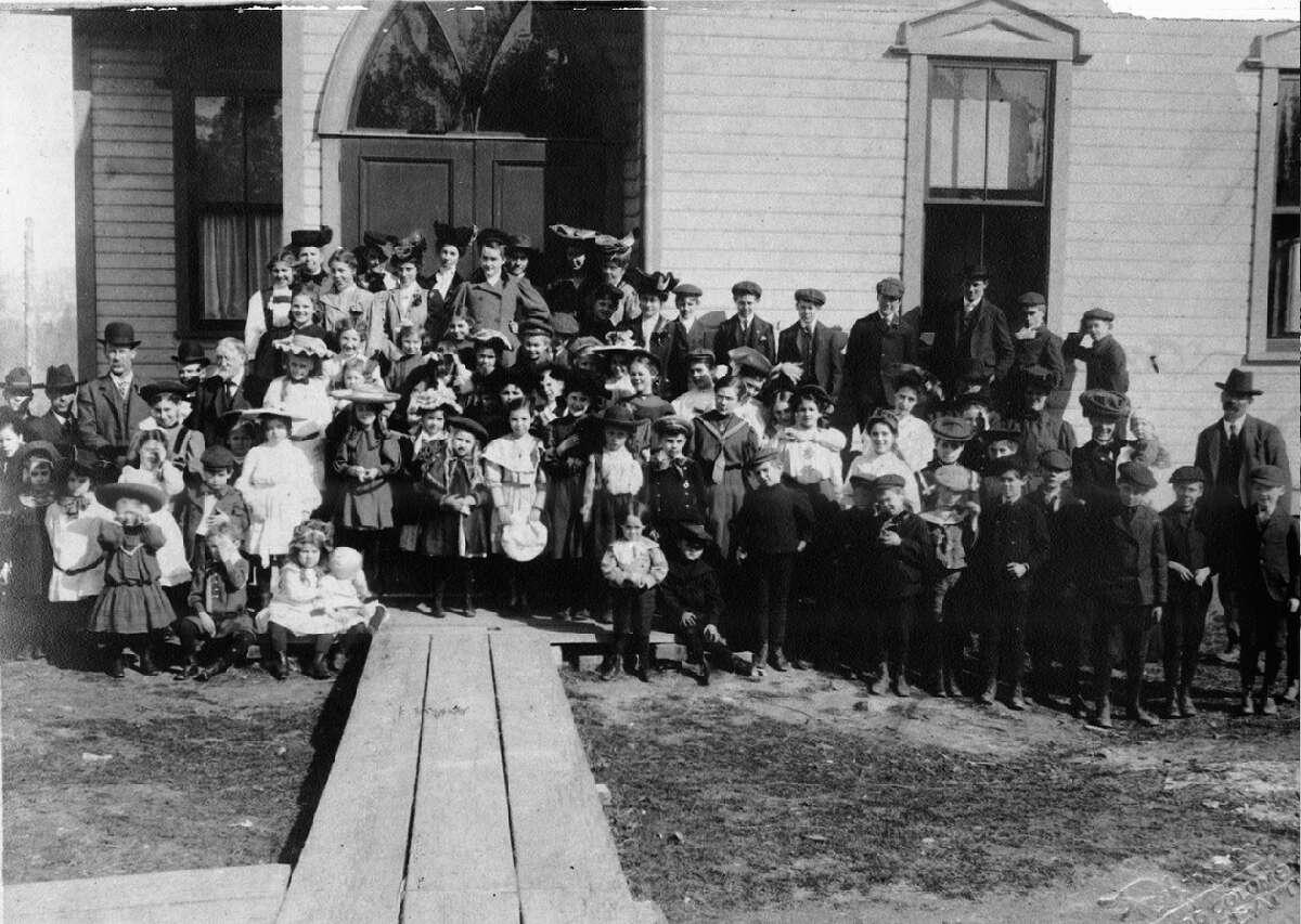 A sunday school class at Rainier Beach M.E. Church, pictured 1906.
