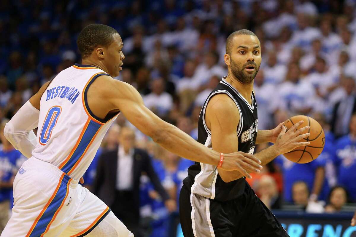 Tony Parkerof the San Antonio Spurs handles the ball against Russell Westbrook of the Oklahoma City Thunder in the first quarter during Game Four of the Western Conference Finals of the 2014 NBA Playoffs at Chesapeake Energy Arena on May 27, 2014.