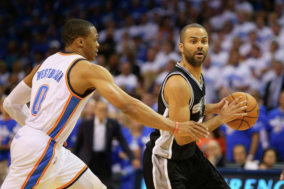 Tony Parkerof the San Antonio Spurs handles the ball against Russell Westbrook of the Oklahoma City Thunder in the first quarter during Game Four of the Western Conference Finals of the 2014 NBA Playoffs at Chesapeake Energy Arena on May 27, 2014. Photo: Ronald Martinez /Getty Images / 2014 Getty Images