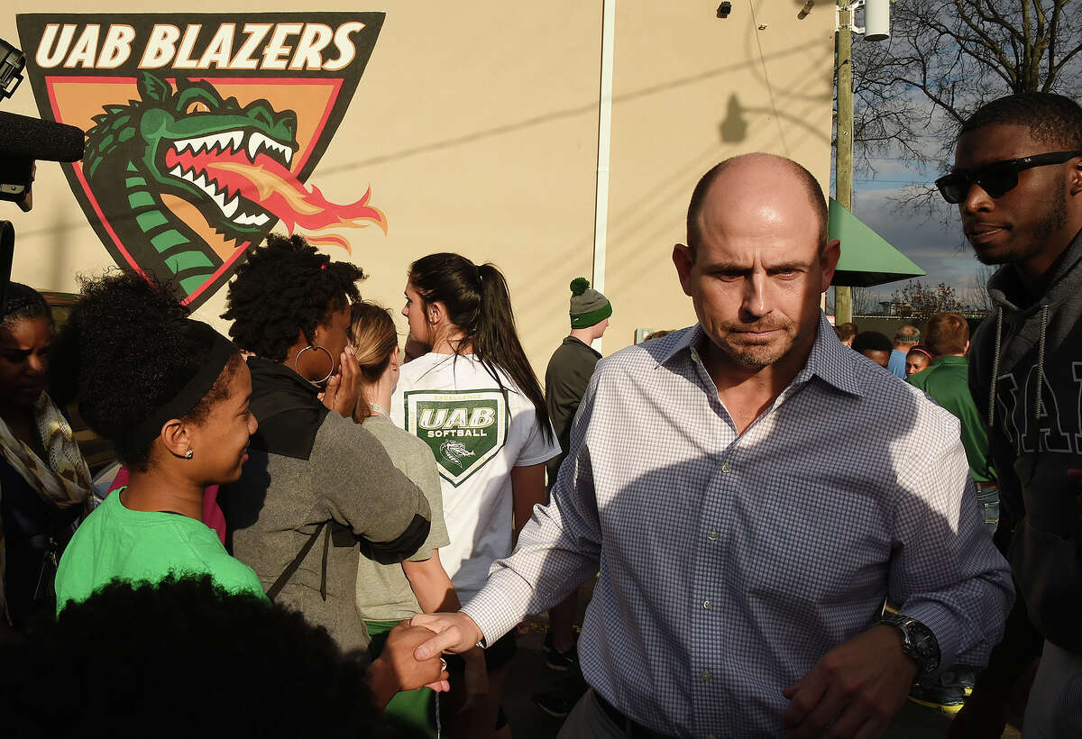 Coach Bill Clark leaves the meeting on Dec. 2, 2014 in Birmingham, Ala.. where UAB announced it is shutting down the football program after one of the Blazers' stronger seasons. The university announced the decision Tuesday minutes after president Ray Watts met with the Blazers players and coaches, while several hundred UAB students and fans gathered outside for the third straight day in efforts to support the program.
