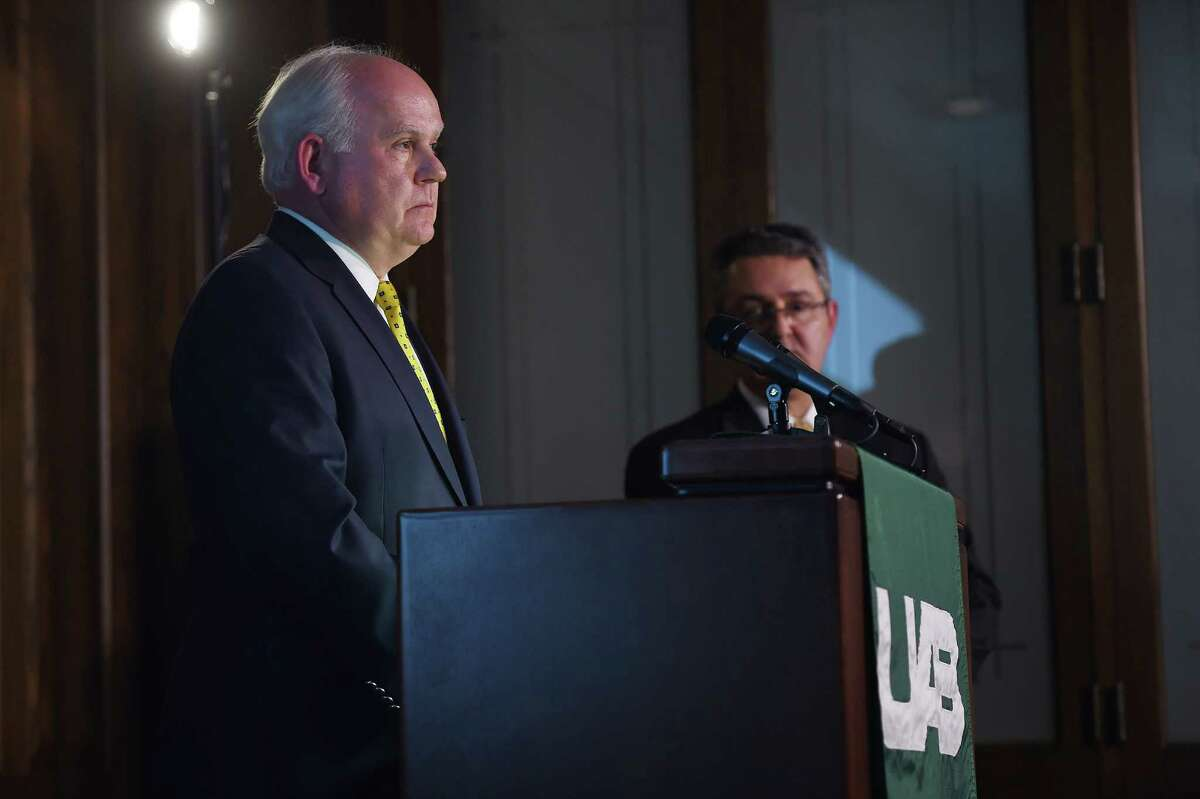 Alabama-Birmingham president Ray Watts (let) and UAB vice president for financial affairs and administration Allen Bolton address the media during a news conference to discuss the results of their athletics strategic planning process and closing of the Blazers' football, rifle and bowling programs.