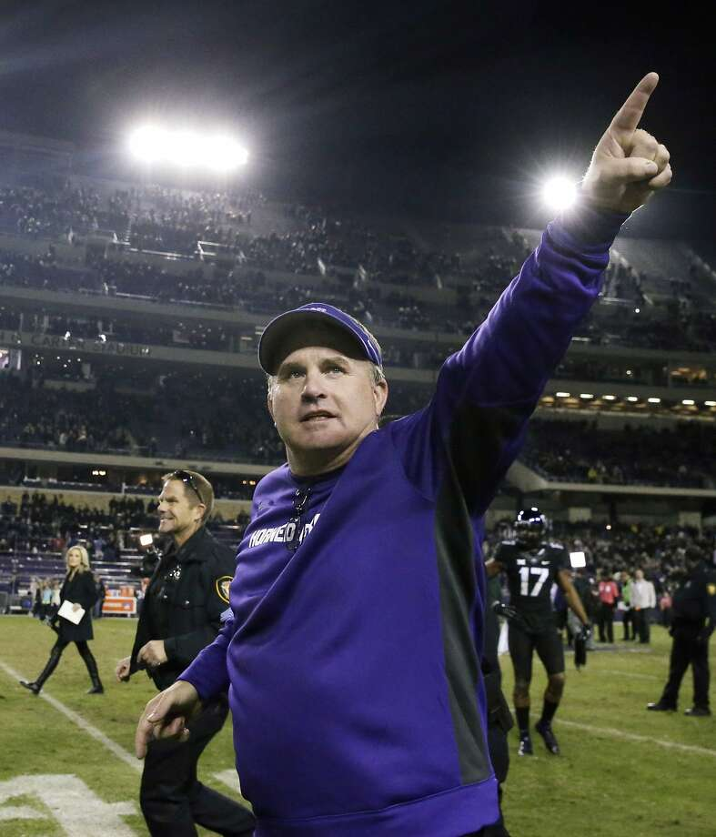 FILE - In tis Nov. 8, 2014, file photo, TCU head coach Gary Patterson points to fans as he runs off the field after an NCAA college football game against Kansas State in Fort Worth, Texas. Patterson was selected as The Associated Press college football coach of the year on Wednesday, Dec. 24, 2014. It was the second time he won the award. He also won in 2009. (AP Photo/LM Otero, File) Photo: LM Otero, Associated Press