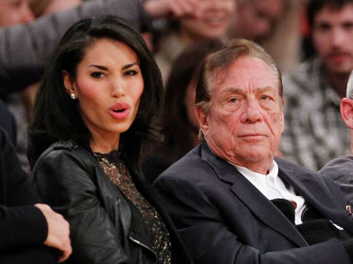 FILE - In this Dec. 19, 2010, file photo, Los Angeles Clippers owner Donald Sterling, right, and V.