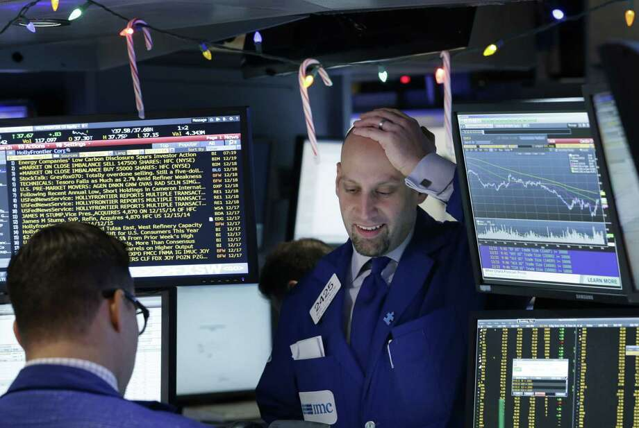 Traders work on the floor at the New York Stock Exchange on Tuesday. Photo: Seth Wenig / Associated Press / AP