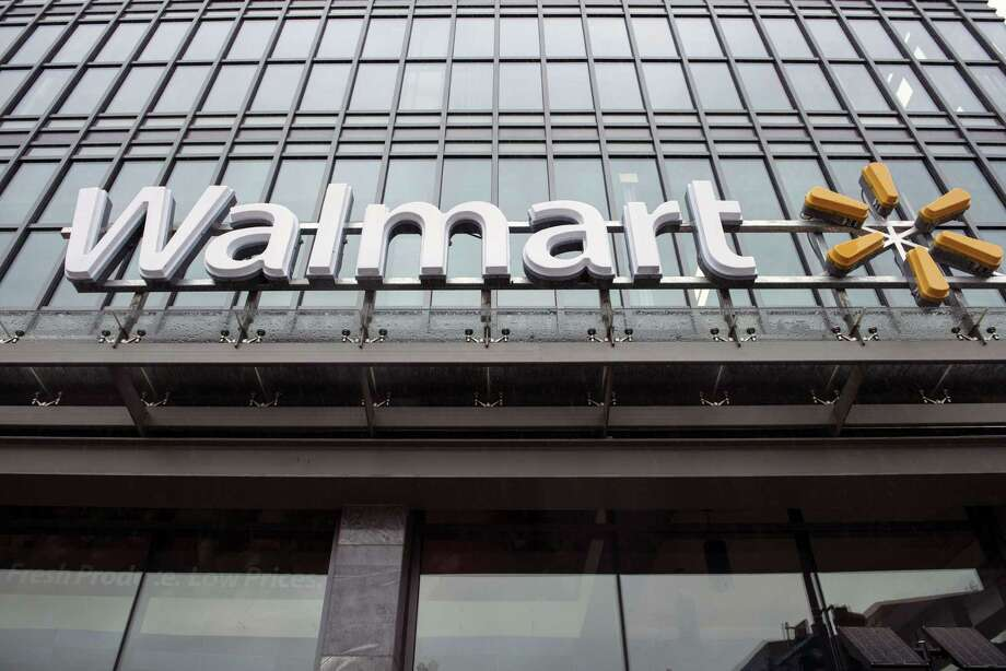 Wal-Mart has teamed with Kroger and the Texas Association of Business to lobby for a law making it legal for public corporations to sell spirits, which currently is illegal in Texas. Photo: BRENDAN SMIALOWSKI, Staff / AFP