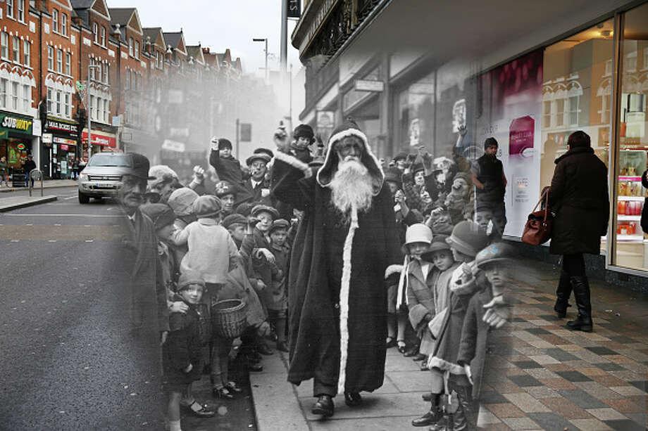 In this digital composite image a comparison has been made of London at Clapham Junction in 1926 (Archive, Topical Press Agency) and Modern Day 2014 (Peter Macdiarmid) at Christmas time.  *** ARCHIVE *** LONDON - NOVEMBER 1926:  Father Christmas arriving at the Arding and Hobbs store on November 2, 1926 in Clapham Junction, London.  (Photo by H. F. Davis/Topical Press Agency/Getty Images) ***MODERN DAY*** LONDON, ENGLAND - DECEMBER 15:  Shoppers walk past Debenhams in Clapham Junction on December 15, 2014 in London, England.  Christmas is an annual religious feast day originally set on December 25 to celebrate the birth of Jesus Christ and is a cultural festival and public holiday celebrated by billions of people around the world. Photo: Peter Macdiarmid, Peter Macdiarmid/Getty Images / 2014 Getty Images