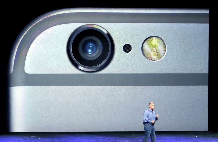 Phil Schiller, Apple senior vice president of worldwide product marketing, discusses the camera features of the iPhone 6 and 6 Plus at a September event. Photo: Marcio Jose Sanchez / Associated Press / AP