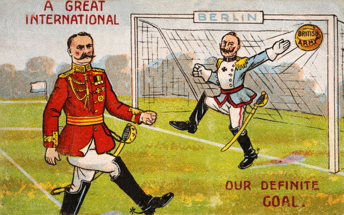 A vintage colour illustration of an officer of the British Army scoring a goal against Berlin whose goalkeeper is a German officer during World War One, circa 1914. This is reminiscent of the