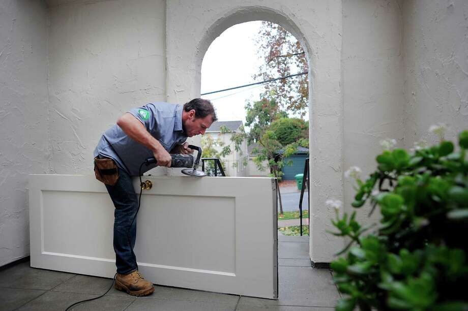 TaskRabbit worker Brian Schrier grinds down the edge of a door that was sticking in its frame at a client's home in Piedmont. Photo: Michael Short / Special To The Chronicle / ONLINE_YES