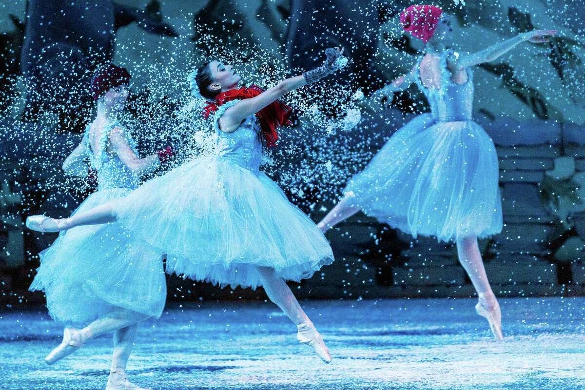 Dancers move through a heavier-than-usual snowfall during the final, annual