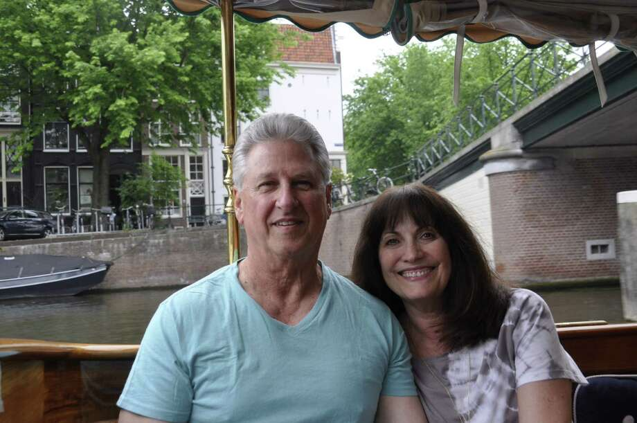 Jo Ann and David Williams on a canal cruise on a canal boat from the Hotel Pulitzer. Winston Churchhill was aboard this boat called the Tourist post-WWII. / ONLINE_YES