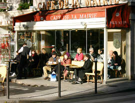 No matter the weather, many Parisians sip their cafe crème on an outside terrace.