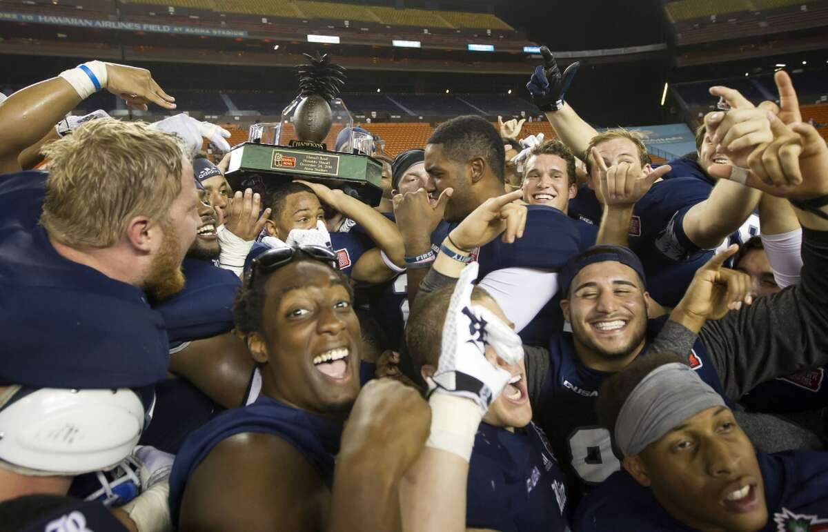 Dec. 24: Rice 30, Fresno State 6 Record: 8-5 The Rice football team hoists the Hawaii Bowl trophy after beating Fresno State in the Hawaii Bowl NCAA college football game, Wednesday, Dec. 24, 2014, in Honolulu. (AP Photo/Eugene Tanner)