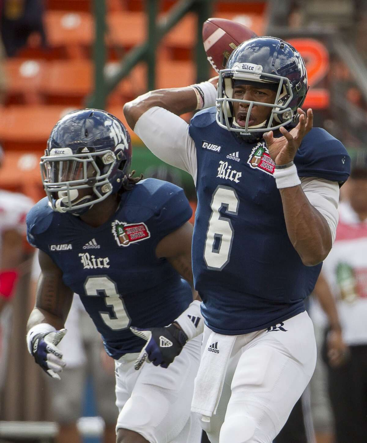 Rice quarterback Driphus Jackson (6) drops back to pass as running back Jowan Davis (3) looks on in the first quarter of the Hawaii Bowl NCAA college football game against Fresno State, Wednesday, Dec. 24, 2014, in Honolulu. (AP Photo/Eugene Tanner)