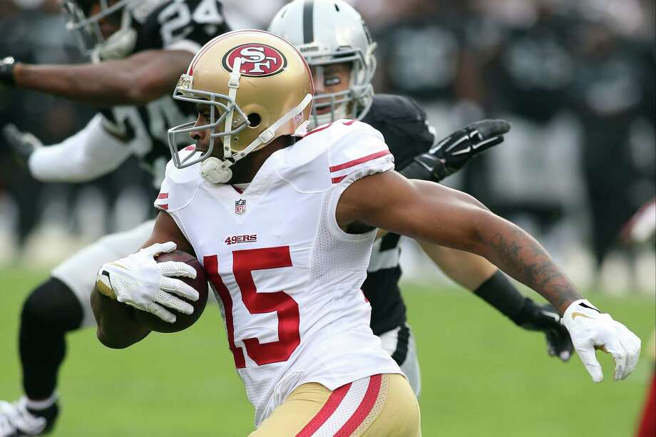 San Francisco 49ers wide receiver Michael Crabtree (15) against the Oakland Raiders during an NFL game at O.com Coliseum in Oakland, Calif. on Sunday, Dec. 7, 2014. (AP Photo/Michael Zito) Photo: Michael Zito / Associated Press / FR171190 AP