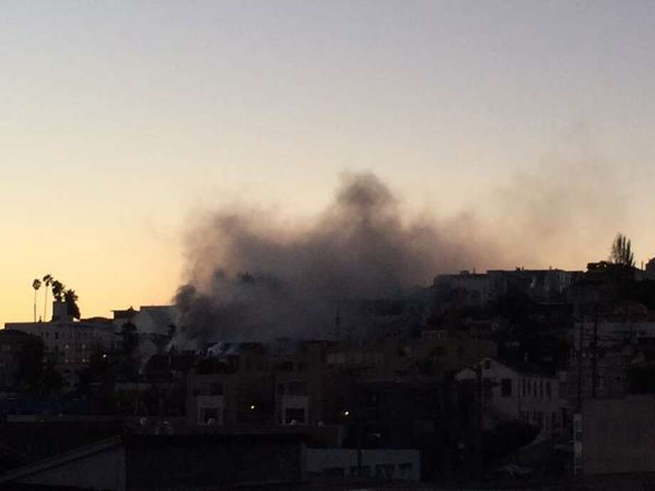 Smoke rises from a three alarm fire at Mississippi and Mariposa in San Francisco on Dec. 25, 2014. Photo: Courtesy Lauren Machado / @lastlolo