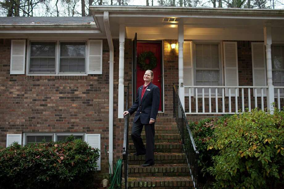 Laura Voisin George, an architectural historian, outside her home in Tucker, Ga., a suburb of Atlanta, Dec. 23, 2014. Like millions of adopted southerners, George is headed home for the holidays — in her case, California, in a seasonal migration that once went in the other direction, in an era when people left the Southeast looking for opportunity. (Dustin Chambers/The New York Times) Photo: DUSTIN CHAMBERS / New York Times / NYTNS