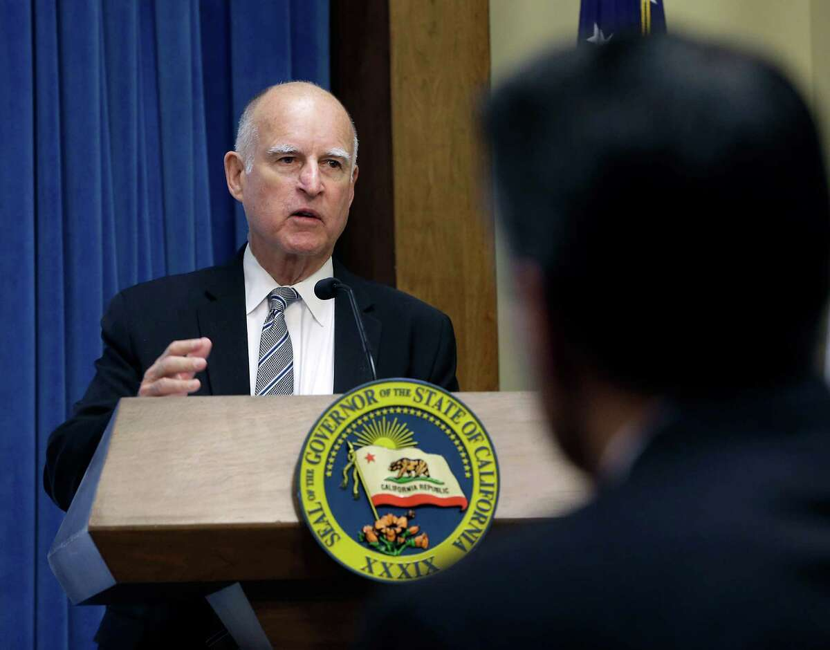 FILE - In this Nov. 13, 2014, file photo, Gov. Jerry Brown makes an opening statement at a meeting of the Western Governors' Association where a panel met to discuss the drought that has gripped California for the last three years, at the Capitol in Sacramento, Calif. Continuing a Christmas Eve tradition, Brown issued pardons to 105 people Wednesday, Dec. 24 before retracting one to a man hours later after learning he had not disclosed recent discipline by financial regulators, a spokesman said. (AP Photo/Rich Pedroncelli, File)