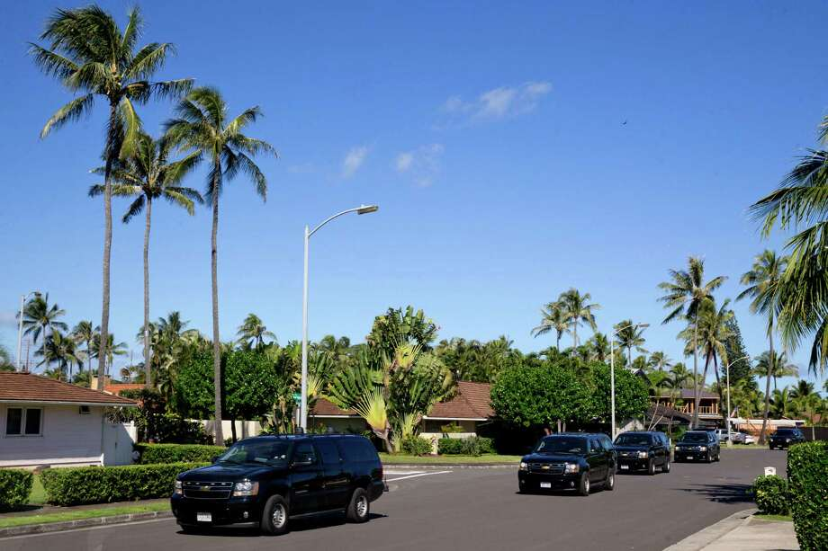 A motorcade carries President Obama and his family from their rental home in Kailua, Hawaii. Photo: Jacquelyn Martin / Associated Press / AP