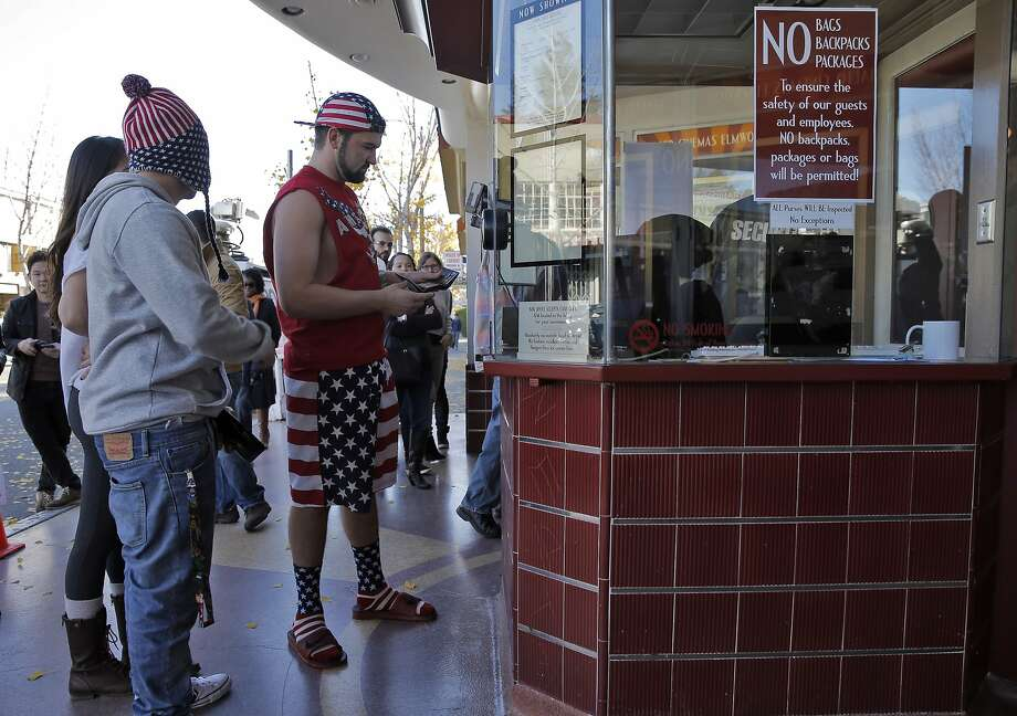 "Kraig Roscoe, center, of Dixon and his friends, Geo Ventura, left, and Maddie Aguilar, far left, wait in line to pick up their pre-paid tickets as atrons gathered at the Elmwood Theater in Berkeley, Calif., on Thursday, December 25, 2014, to watch the movie, ""The Interview."" Following the controversial hacking scandal that hit Sony Pictures and threats of violence if the movie was released, Sony did an about face and released the movie after criticism of its decision not to show the movie. Photo: Carlos Avila Gonzalez, The Chronicle"
