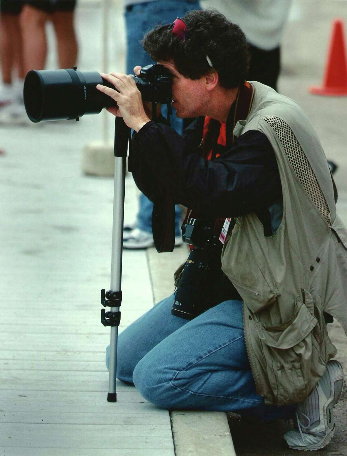 Judge Bert Richardson photographing an event in 2002.