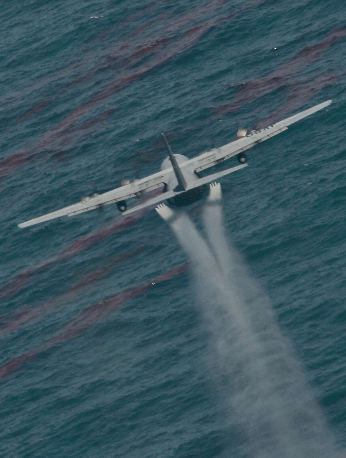 An Air Force C-130 drops oil-dispersing chemicals into the Gulf of Mexico after the April 2010 spill.