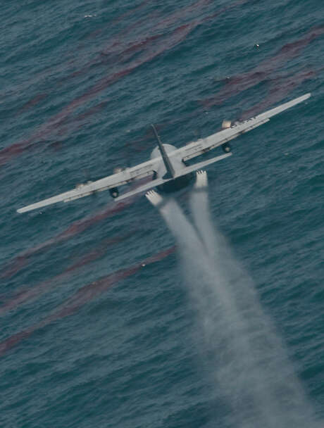 An Air Force C-130 drops oil-dispersing chemicals into the Gulf of Mexico after the April 2010 spill. Photo: TSgt. Adrian Cadiz, 1 CTCS / digital