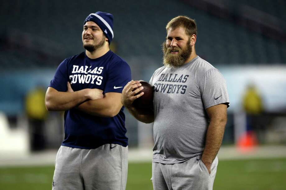 Dallas Cowboys offensive linemen Zack Martin (left) and Travis Frederick talk during warm-ups before the road game against the Philadelphia Eagles on Dec. 14, 2014. Photo: Matt Rourke /Associated Press / AP