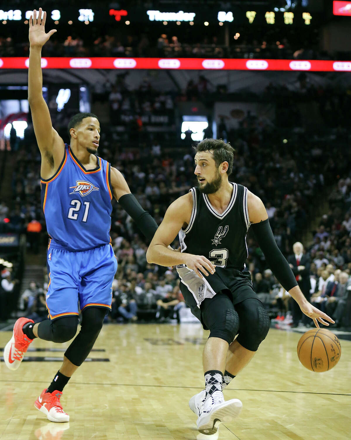 Andre Roberson defends Marco Belinelli during the second half.