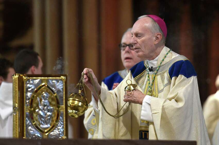 The Reverend Howard Hubbard, Bishop Emeritus of Albany officiates at the Cathedral of Immaculate Conception during the 11 a.m. observance of the Christmas Day Mass Dec. 25, 2014 in Albany, N.Y. (Skip Dickstein/Times Union)