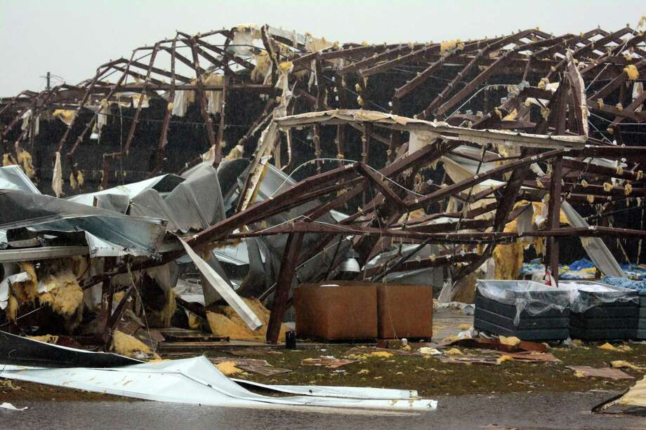 A building is severely damaged on US 98 East near Columbia, Miss., after a tornado touched down. Photo: Eli Baylis / Associated Press / The Hattiesburg American