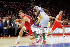 Blake Griffin's size was too much for the Warriors' front line, including Draymond Green (right).