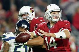 GLENDALE, AZ - DECEMBER 21:  Quarterback Ryan Lindley #14 of the Arizona Cardinals throws a pass during the third quarter of the NFL game against the Seattle Seahawks at the University of Phoenix Stadium on December 21, 2014 in Glendale, Arizona.  The Seahawks defeated the Cardinals 35-6. (Photo by Christian Petersen/Getty Images)