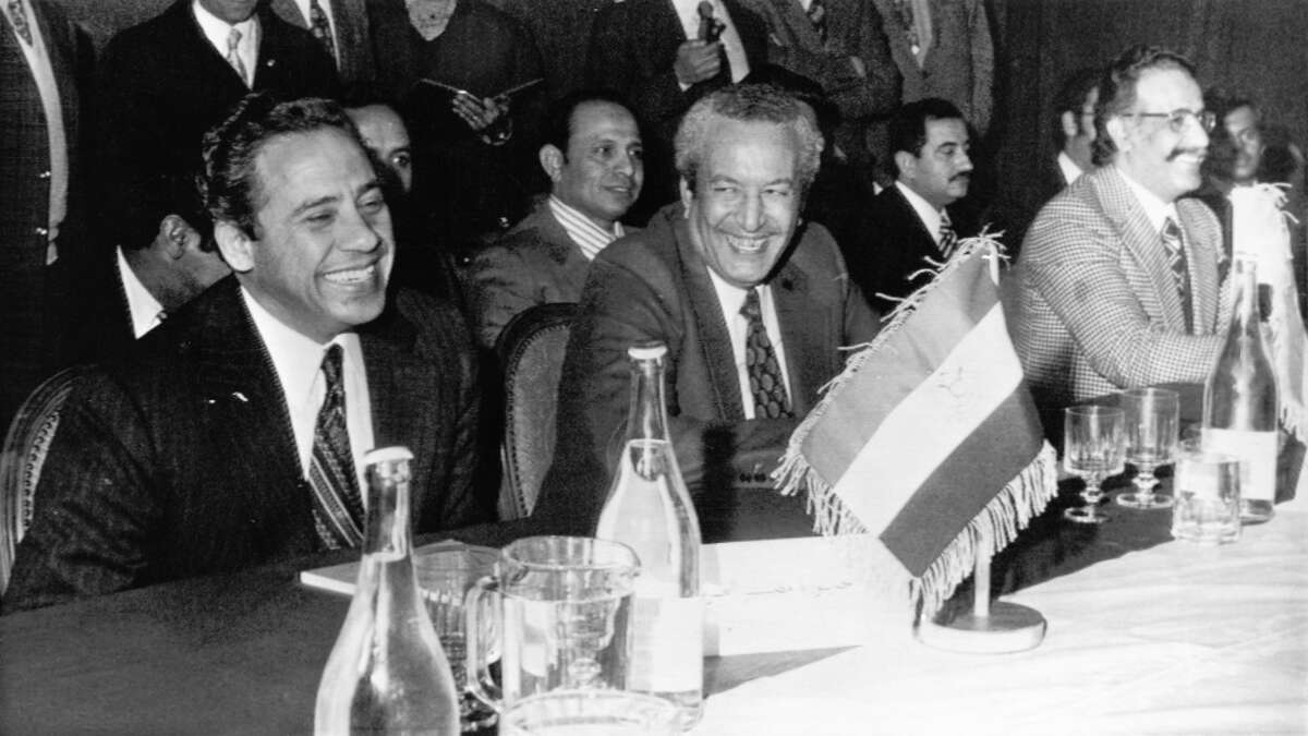Tripoli, LIBYA, Mar. 14, 1974 -- (L-R) Egyptian oil minister Ahmed Hallal, Libyan oil minister Ezzedin Mabrouk and Kuwait finance minister Abdul Rhaman Al-Atiki share a laugh during oil meeting in Tripoli, Libya. (AP Wirephoto) (sp stf Saris) 1974