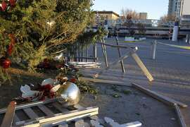 Broken ornaments are piled under the Christmas tree at Jack London Square in Oakland, Calif. on Friday, Dec. 26, 2014 after vandals smashed storefront windows and damaged the holiday display on Christmas night.