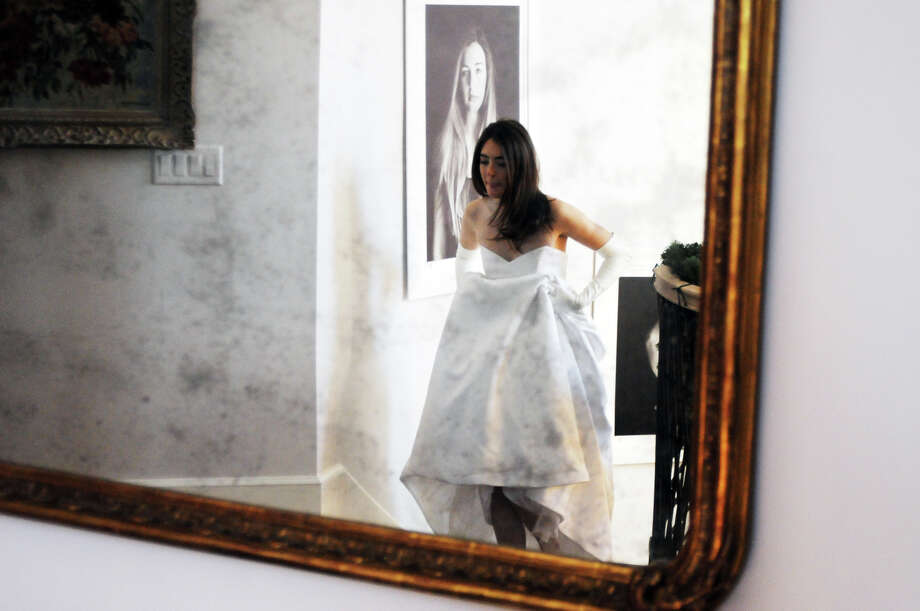 Madison Olmstead, 19, photographed wearing a vintage Christian Dior gown at her home in Greenwich, Conn., Dec. 26, 2014. She will wear the dress as she makes her social debut during the 60th Annual International Debutante Ball at the Waldorf Astoria on Monday, Dec. 29. Photo: Keelin Daly / Stamford Advocate Freelance