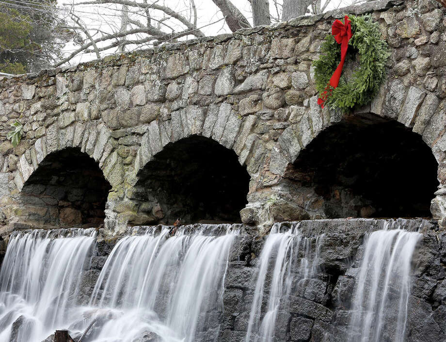 An annual Christmas tradition in Manchester is a Christmas wreath that appears on the Case Mountain Bridge every December. It is a mystery who adds the holiday flair to the bridge, but it is enjoyed by the community. Photo: Jared Ramsdell, Jared Ramsdell/Journal Inquirer / Associated Press