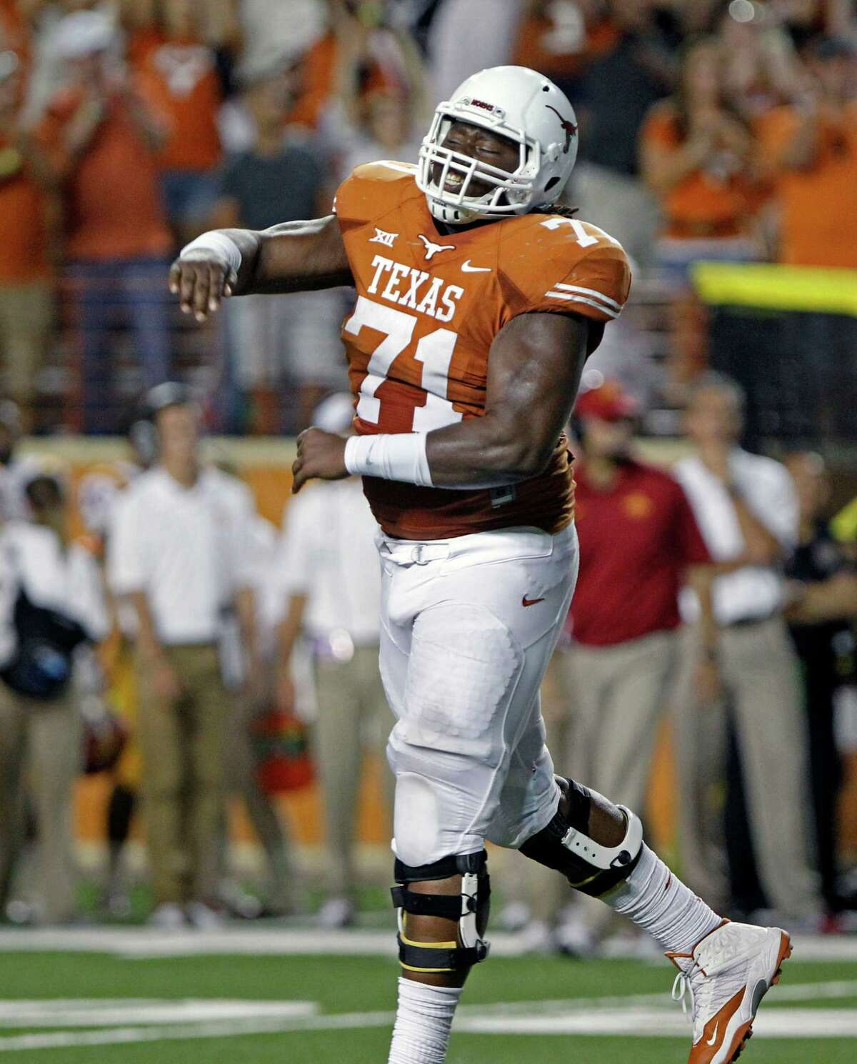 UT offensive lineman Camrhon Hughes celebrates Nick Rose's last-second field goal that gave the Longhorns a 48-45win over Iowa State on Oct. 18, 2014, in Austin.