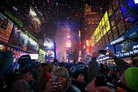 Revelers ring in 2014 in New York's Times Square. Most Americans look back on this year and shrug.