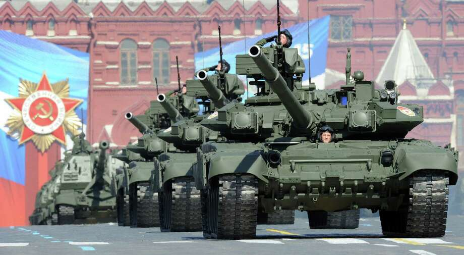 A column of Russia's T-90 tanks roll down Red Square in Moscow, during the annual Victory Day parade in May that marks the surrender of Nazi Germany to Russia. Russia has an updated version of its military doctrine, which reflects the emergence of new threats against its national security with NATO military buildup and U.S. Prompt Global Strike concept listed among them. Photo: YURI KADOBNOV / AFP/Getty Images / AFP