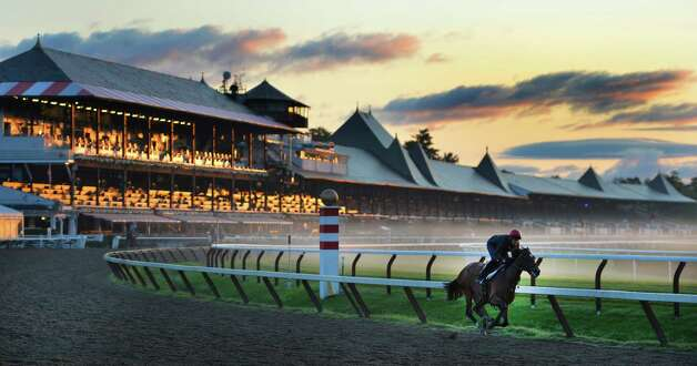Tracey Wilkes gives Birdmaker a workout Monday morning, Aug. 18, 2014, as the mist overtakes the main track at the Saratoga Race Course in Saratoga Springs, N.Y.    (Skip Dickstein/Times Union) ORG XMIT: MER2014081816193209 Photo: SKIP DICKSTEIN, ALBANY TIMES UNION