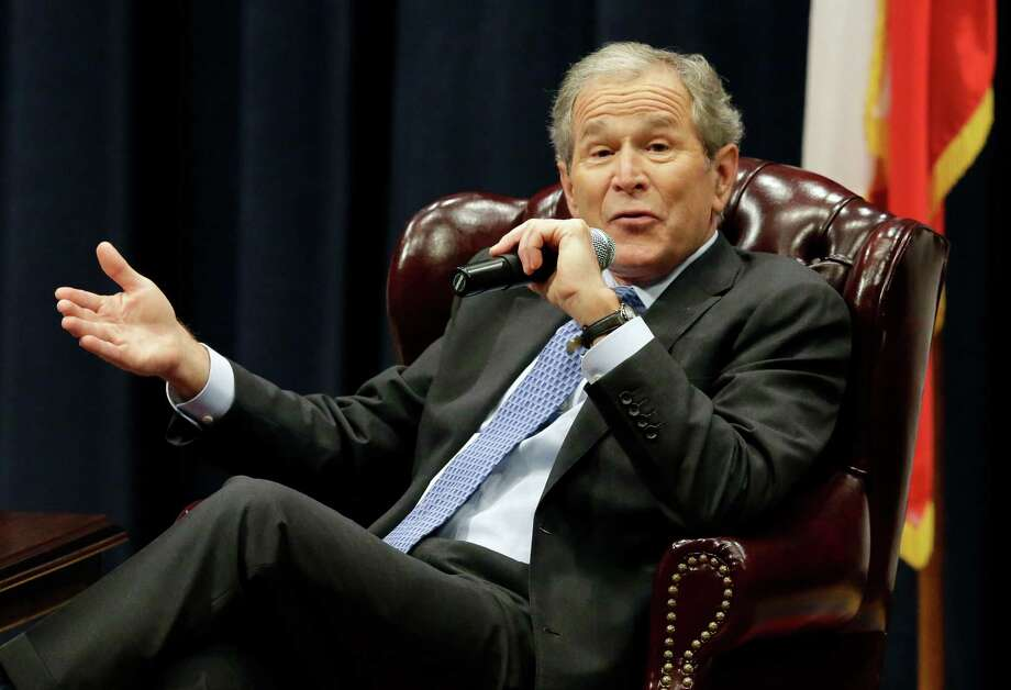 Former President George W. Bush has declined to criticize President Barack Obama, choosing to honor the presidency rather than demean the current occupant. Photo: Pat Sullivan /Associated Press / AP
