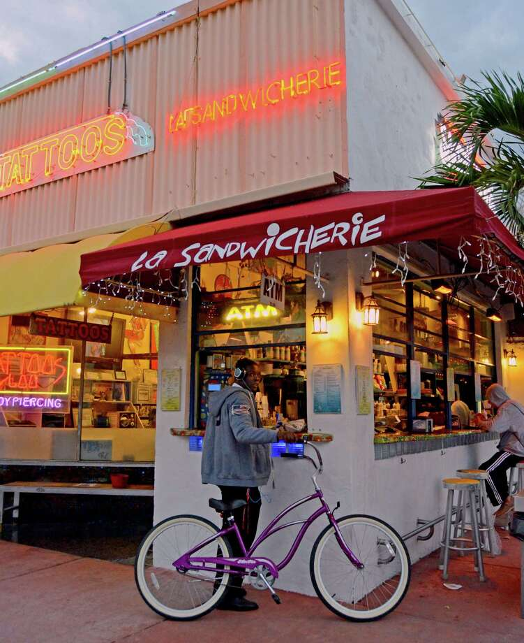 La Sandwicherie is a highlight of South Beach's side streets, where travelers will find inexpensive local favorites for food, accommodations and souvenirs. Photo: Jennifer Kay, STF / AP